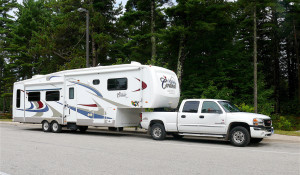 Insurance for RV -  a white truck pulling a Fifth Wheel Trailer