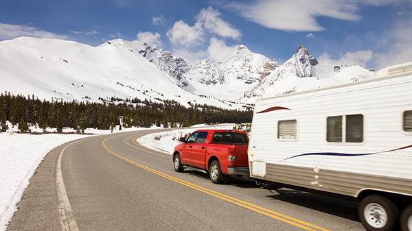 RV on Road with Snowy Mountains_000010453937