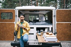 preparing meal in van
